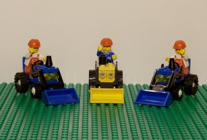 Lego workers on trucks.